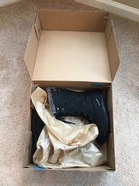 pair of brown leather boots in box