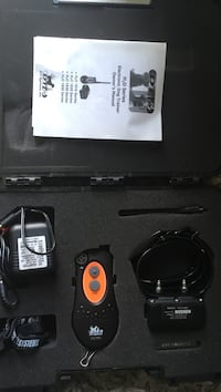 black and orange electronic dog trainer