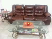 Reclining leather sofa and loveseat. Coffee table and 2 end tables. New Orleans