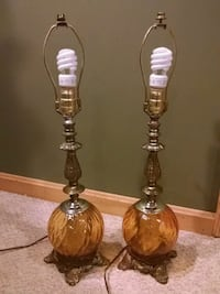 2 amber colored antique lamps