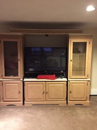 Flat screen television with brown wooden tv hutch Tewksbury, 01876