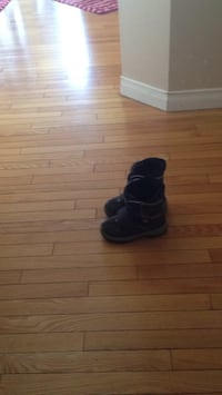 pair of black leather boots Calgary, T3B 2T3