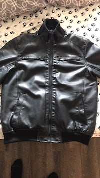 Black leather zip-up jacket.