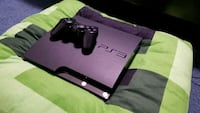 Black Sony PS3 slim console with controller Frederick