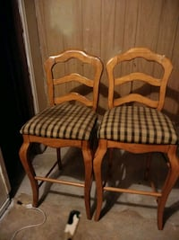two brown wooden framed white and black padded armchairs Oklahoma City, 73135