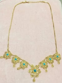 Gold necklace with blue gemstone pendant Vancouver, V5V