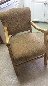 beige wooden framed floral fabric padded armchair