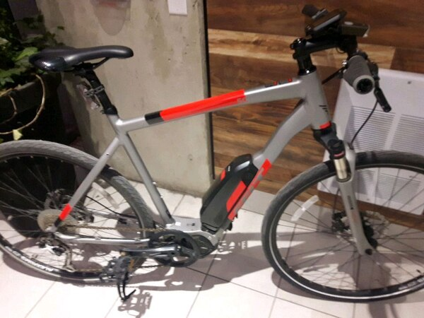 Petal assist gray and red hardtail mountain bike
