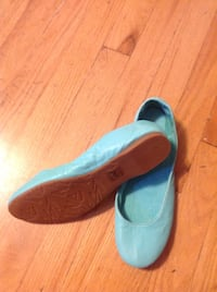 pair of blue suede slip-on shoes Toronto
