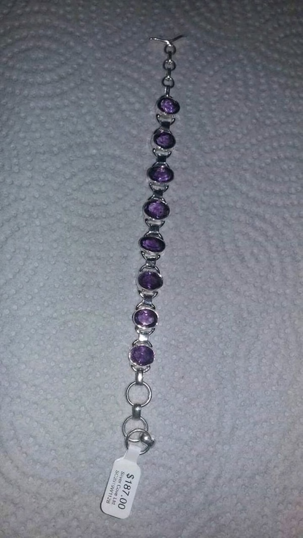 Brand new Amethist bracelet with all silver