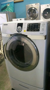 white Samsung front-load clothes washer Lynwood, 90262