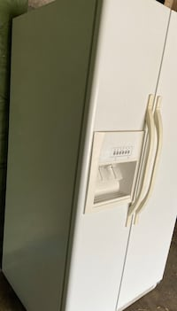 Whirlpool side by side refrigerator in white