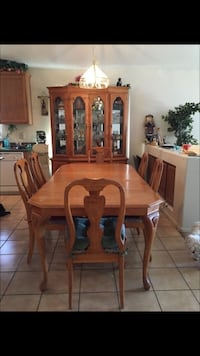 brown wooden six chairs dining set