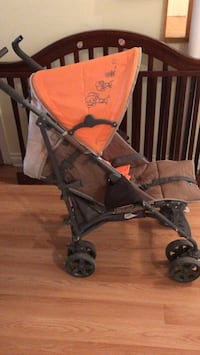 Baby's black and orange stroller Montreal, H8N 2B6
