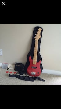 red and black electric guitar Toronto, M2M 1P6