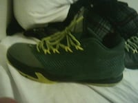 pair of green basketball shoes