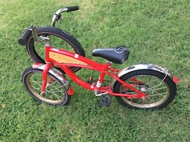 "Schwinn 16"" red bicycle."