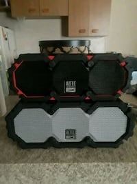 black and red Altec Lansing portable speaker null