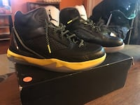 white-black-and-yellow Air Jordan basketball shoes