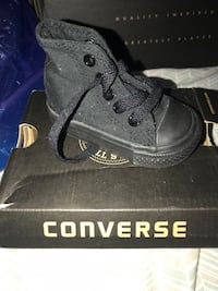 Unpaired black converse high top sneakers with box
