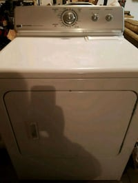 white front-load clothes dryer 565 km