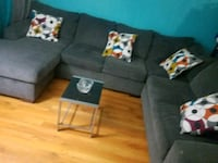 black fabric sectional sofa with throw pillows Los Angeles, 91352