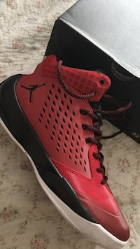 Red and black air jordan basketball shoe with box