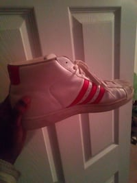 unpaired red and white Adidas high-top sneaker