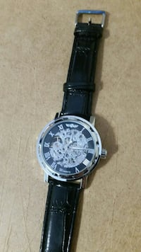 round silver watch with black leather  Ottawa, K1V 6G4