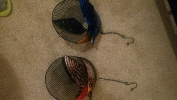 two round blue and red bird head decors