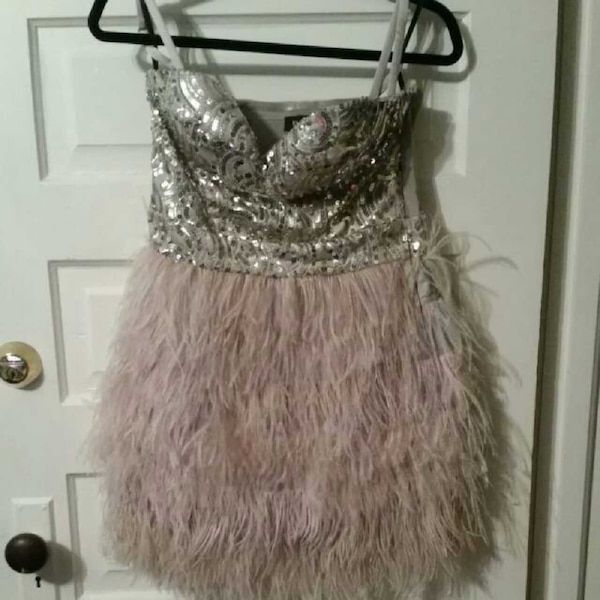 b810e57dbf Used bebe Isis Sequin Feather Dress in size medium for sale in Sarnia -  letgo