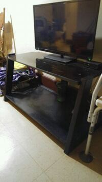black flat screen TV with black wooden TV stand Halifax