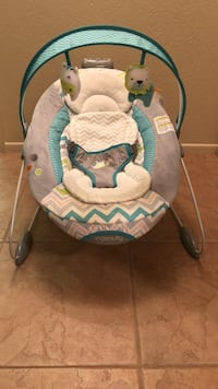 Baby's automatic bouncer! gray, blue, and white ingenuity bouncer