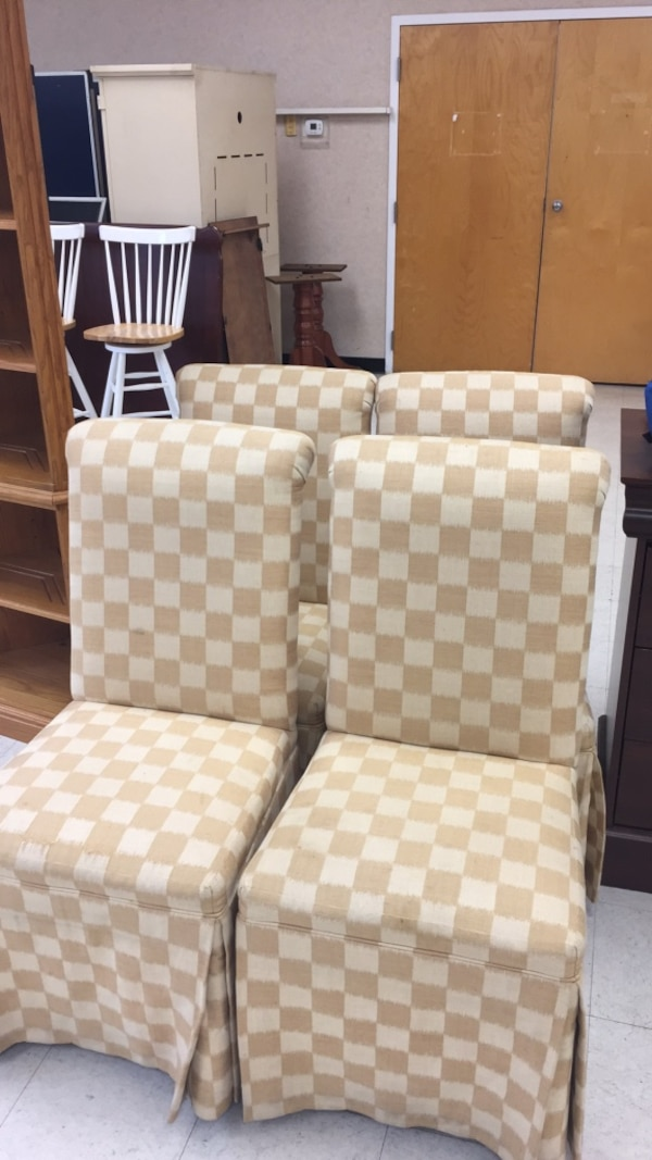 two white-and-gray checkered padded chairs