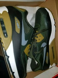 pair of black-and-green Nike running shoes Evansville, 47711