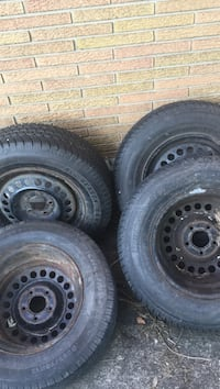 black bullet hole car wheel with tire set St Catharines, L2T 3P8