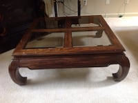 brown wooden framed glass top coffee table 535 mi