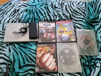Ps2 slim silver with power adaptor and 5 games.  St. Thomas, N5R 2K9