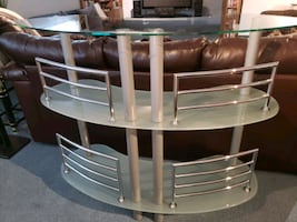 Glass bar table. 3 tier glass with chrome details.