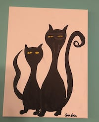 two silhouette cats painting