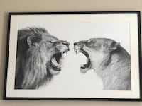 lion and lioness charcoal painting in black plastic frame