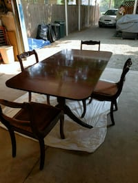 round brown wooden table with four chairs dining set Spokane Valley, 99216