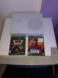 Xbox one s and two games