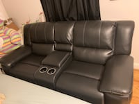 Leather theater style couch with cup holders. Used only few months, paid $1500. My loss your gain. $600 OBO Mc Lean, 22101