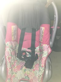 Pink and black floral print car seat carrier
