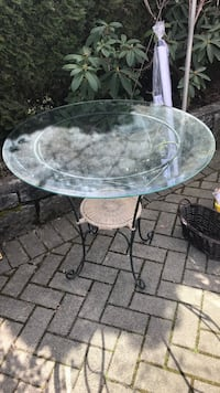 Round white metal framed glass top patio table Port Coquitlam, V3B 5H7