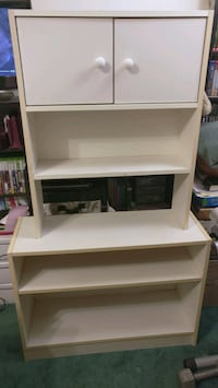 Two part shelf with cupboard