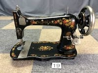 black and brown treadle sewing machine Silver Creek