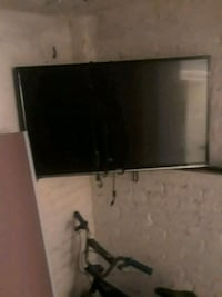 black flat screen TV with remote Brooklyn, 11208