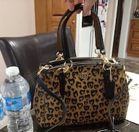 "Brand New with Tag Coach In Ocelot Purse Double strap with 23"" drop for shoulder or crossbody wear paid for $350 plus tax, in smoke free and petfree home pickup kennedy and Sandalwood Brampton, L6Z"